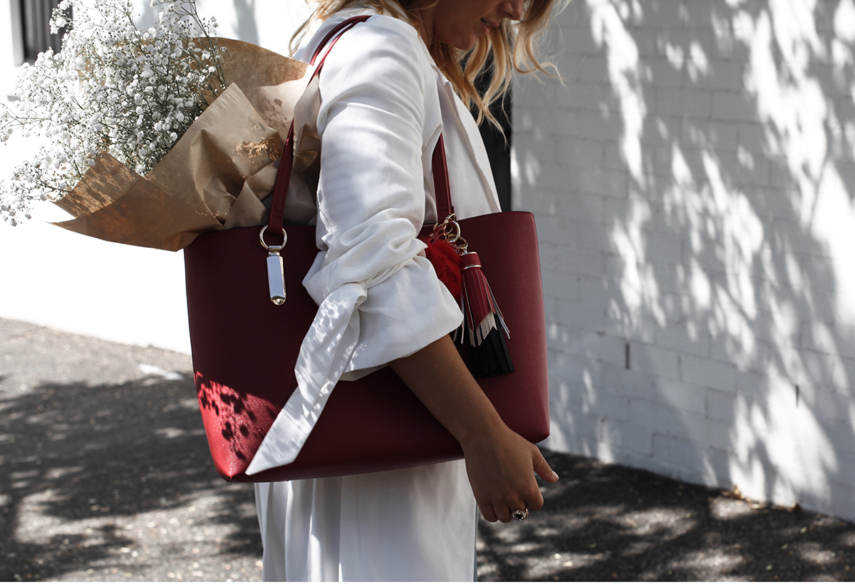 0877b12a3545 See Want Shop blogger Lisa Hamilton styling a red tote bag with a white  trench coat ...