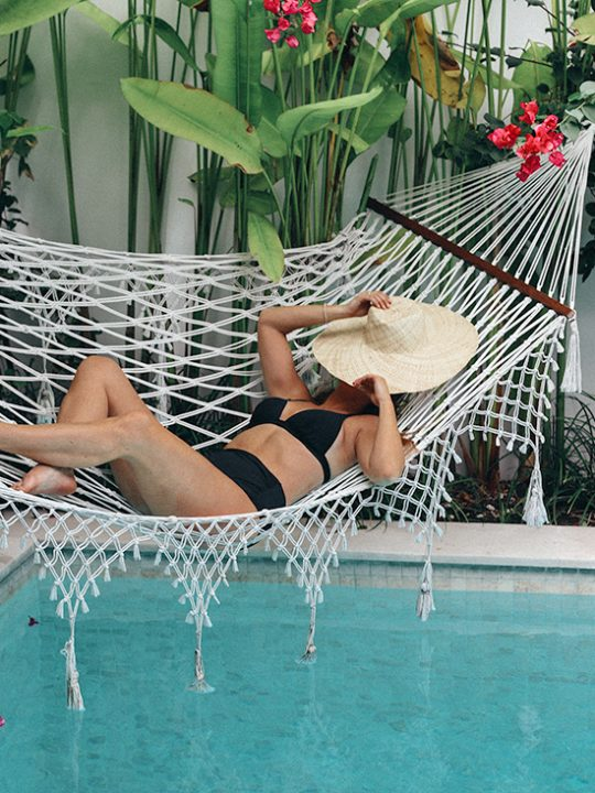 wearing black bikini in bali hammock
