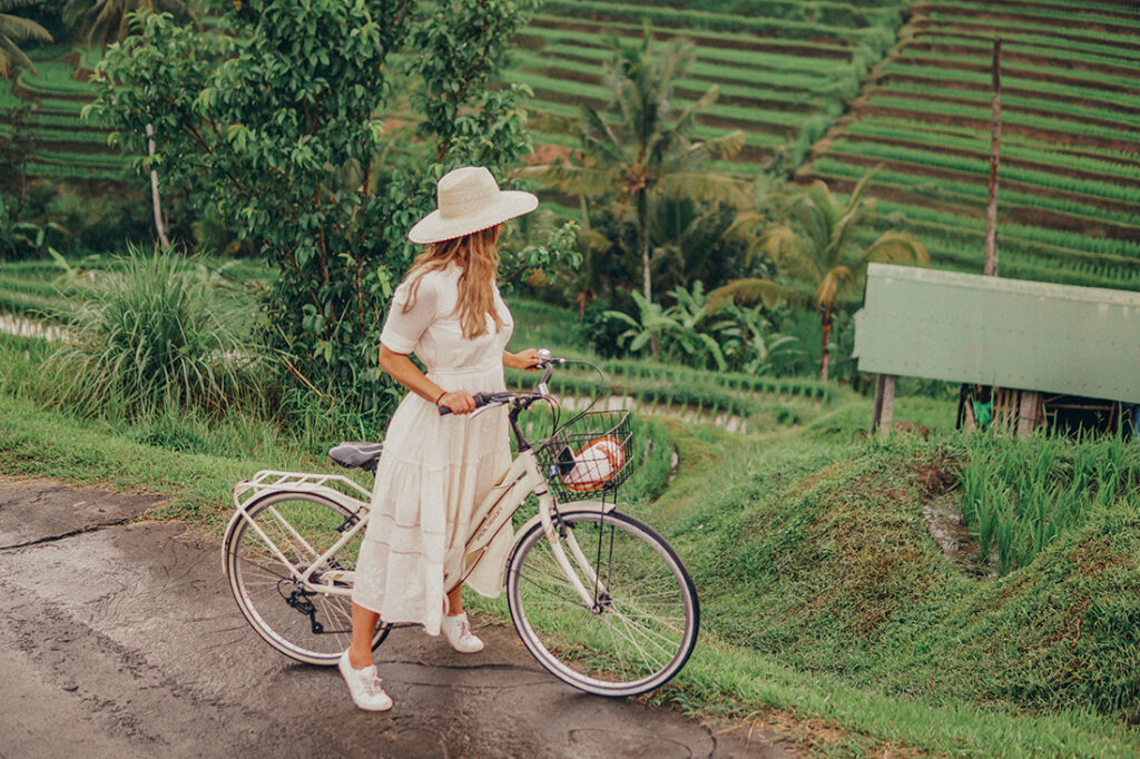 bike riding through rice fields in Bali